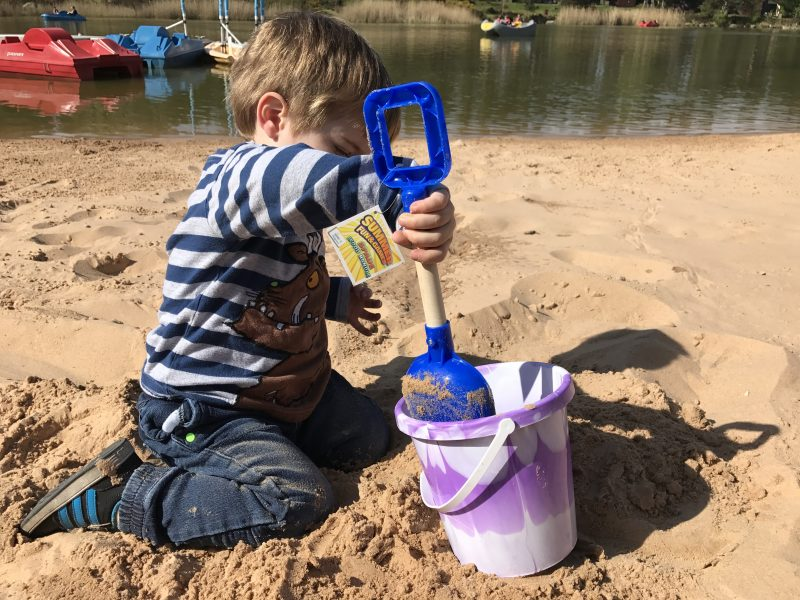 building sandcastles at whinfell forest beach