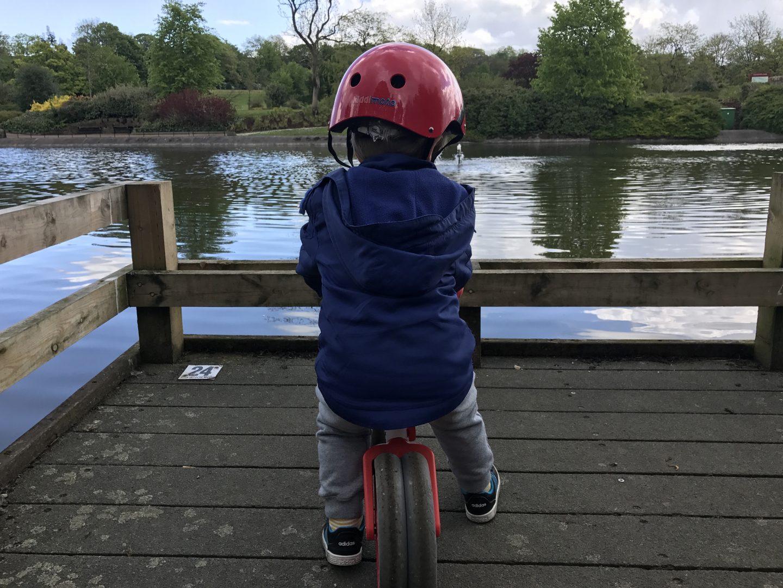 on his balance bike