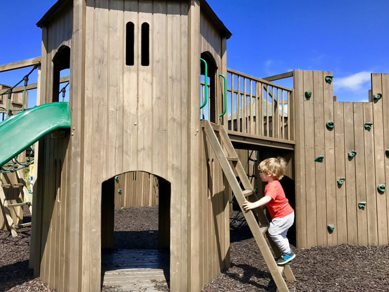 toddler scales the playground at gypsy wood