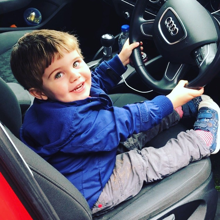 toddler pretending to drive